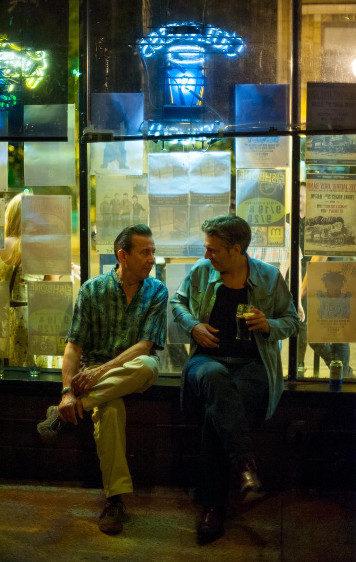 Talking under the neon lights.